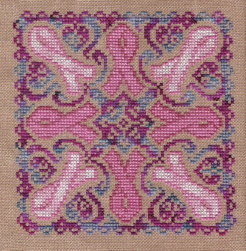 cross stitched mandala pattern featuring pink breast cancer awareness ribbon