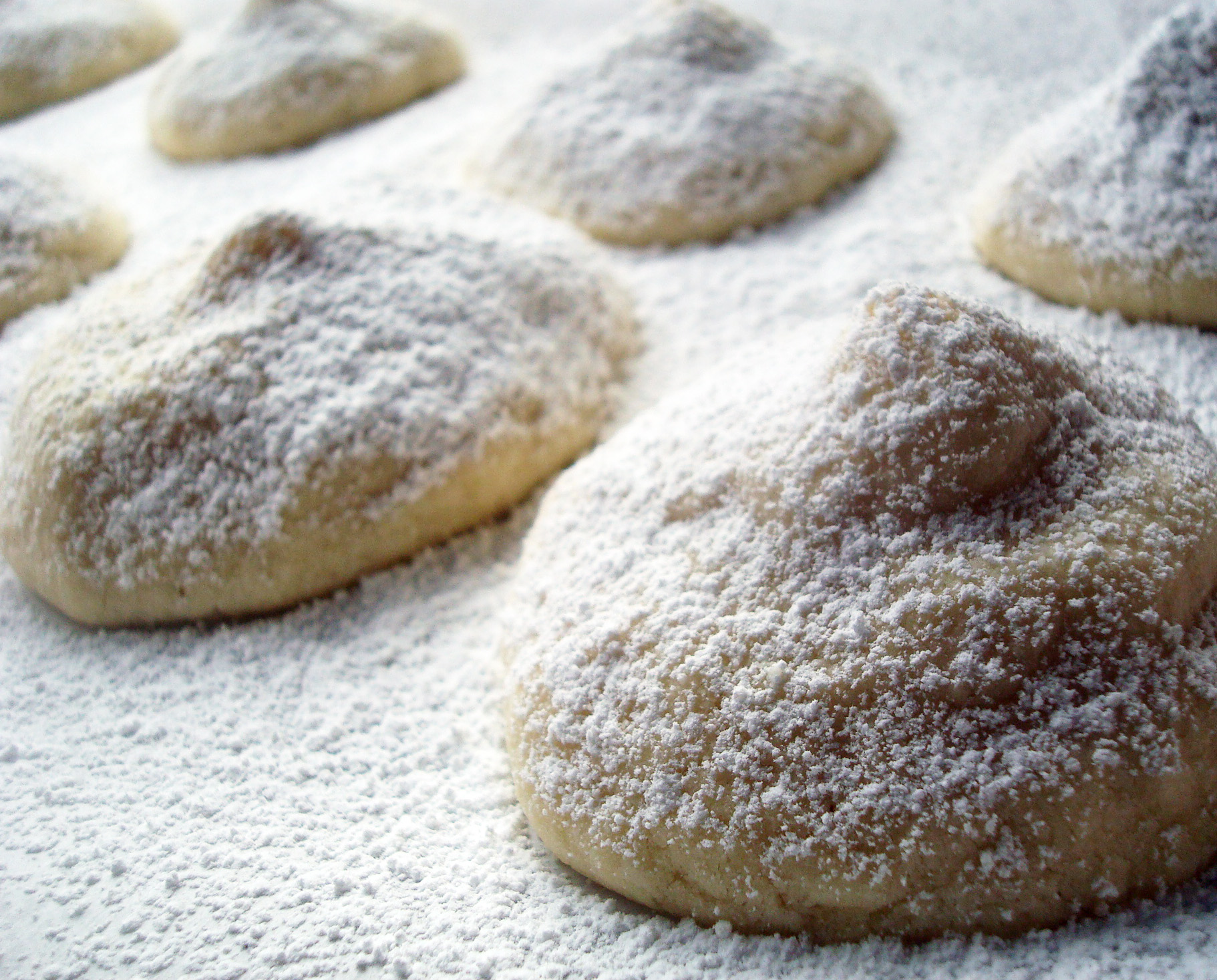 Filled cookies with sugar on top