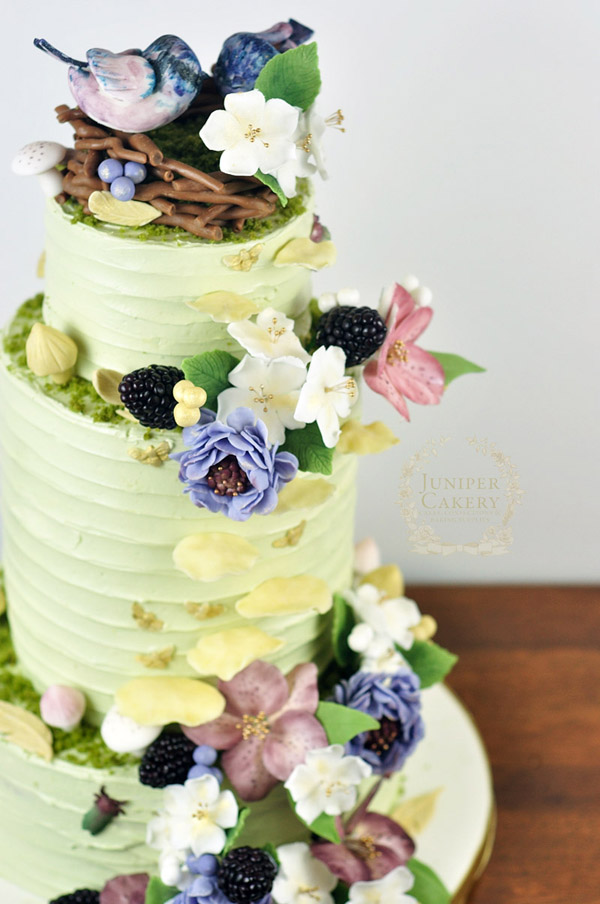 Rustic buttercream wedding cake with woodland florals by Juniper Cakery