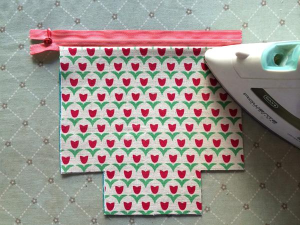 press layers away from zipper