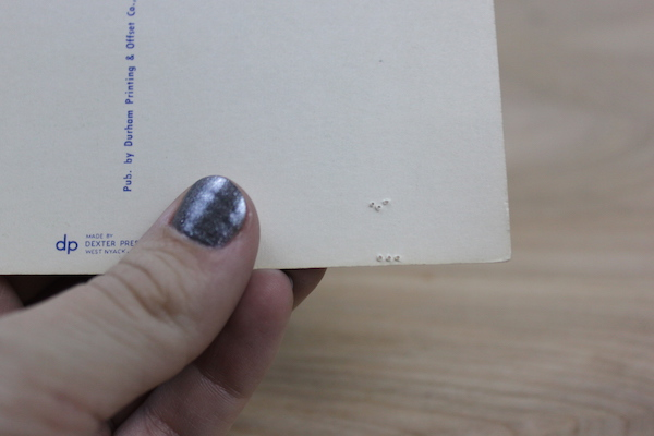 Holes punched in the postcard