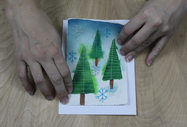 attaching embroidered paper to the card