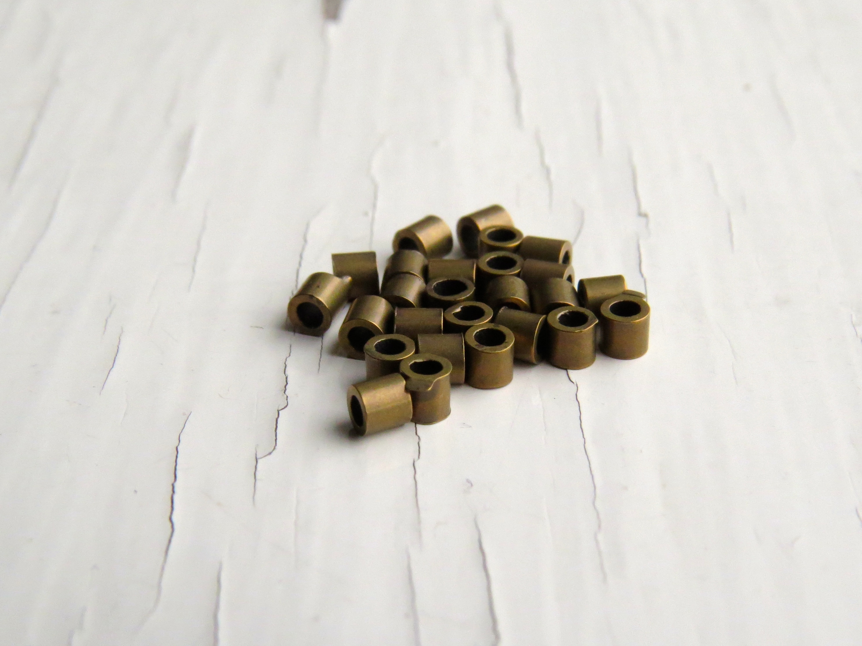 Antiqued brass crimp tubes