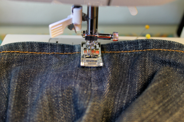 tack jeans hem in place at side seams