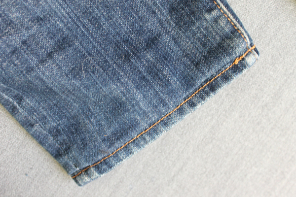 Finished jeans with original hem