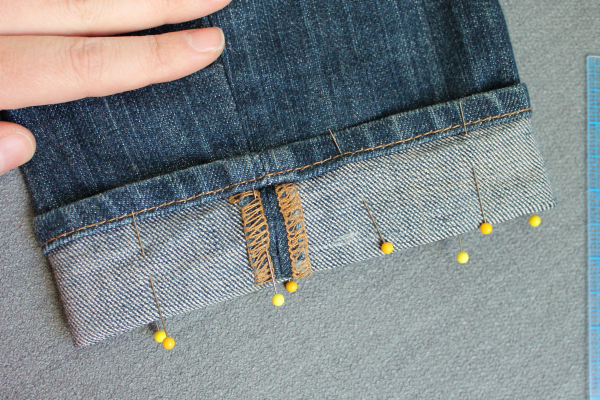 pinning new hem of jeans with straight pins