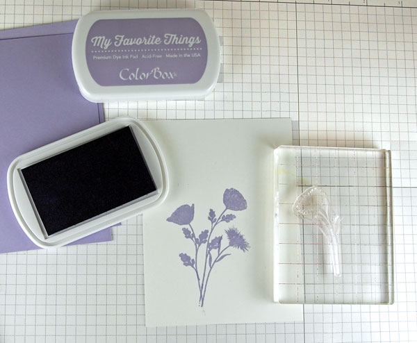 Lavender flowers stamped onto white card stock.