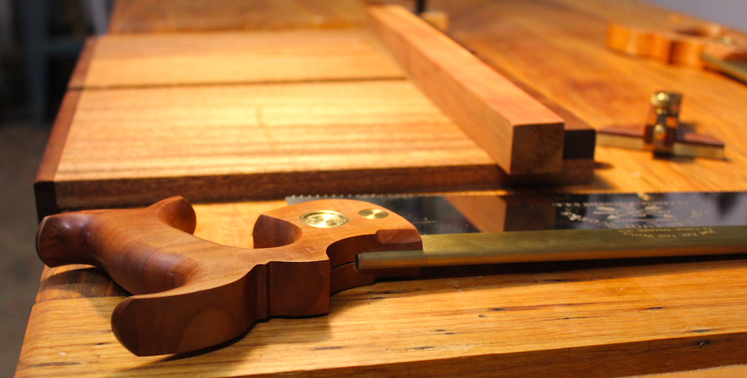 Handsaw is pictured next to a bench hook