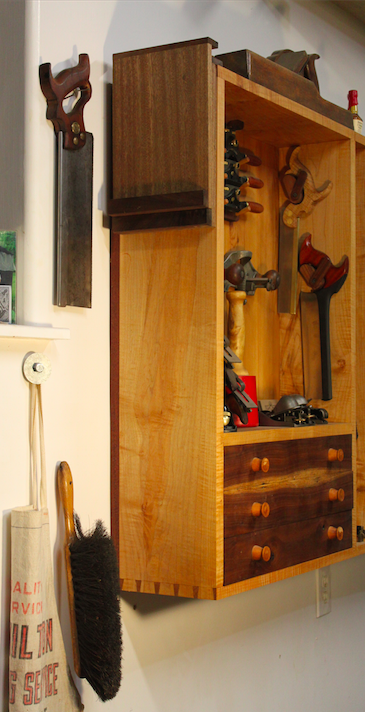 Bench hooks are stored on a tool shelf