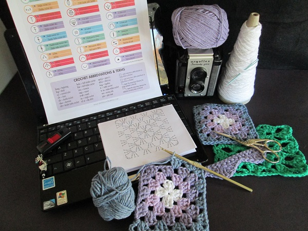Crocheting granny squares using symbols and diagrams