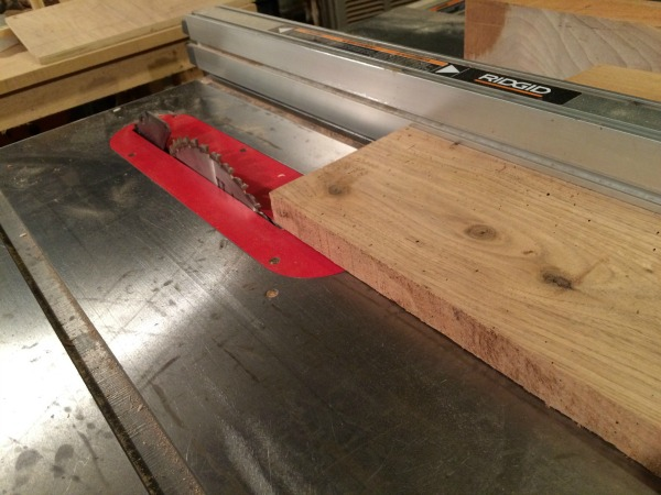 ripping board on table saw