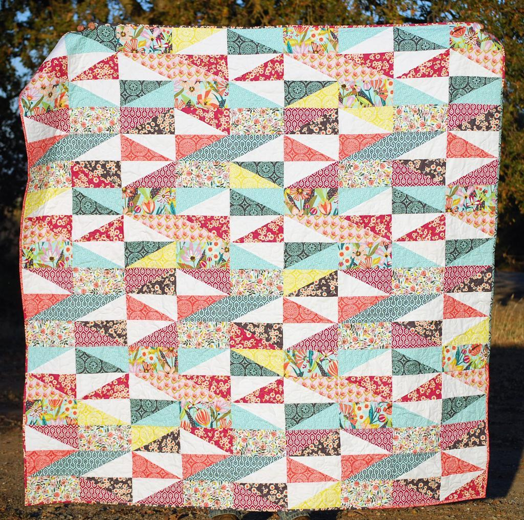 patchwork quilt with rectangles and triangles