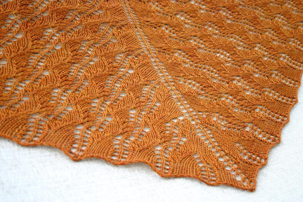 Displacement knitted shawl