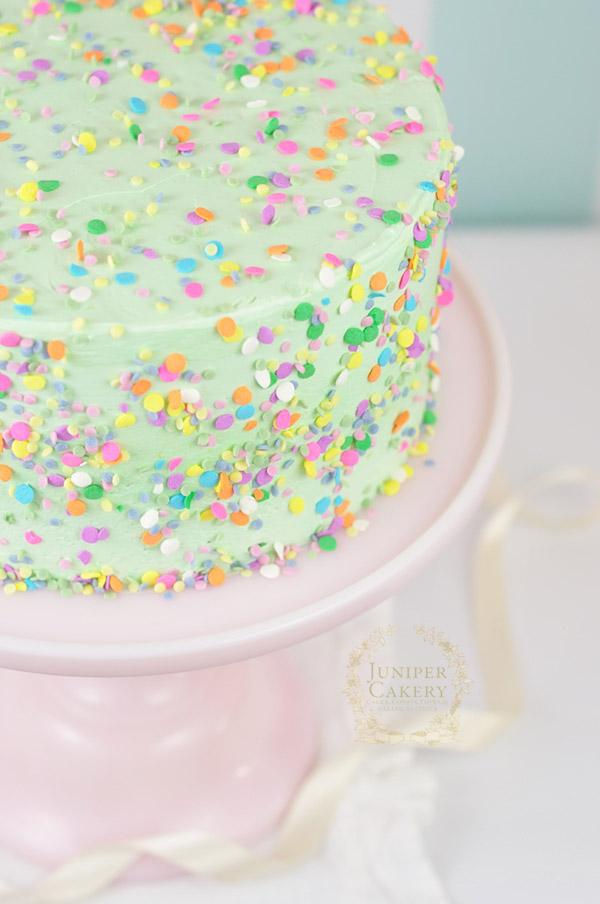 Fun gluten free confetti cake with recipe by Juniper Cakery