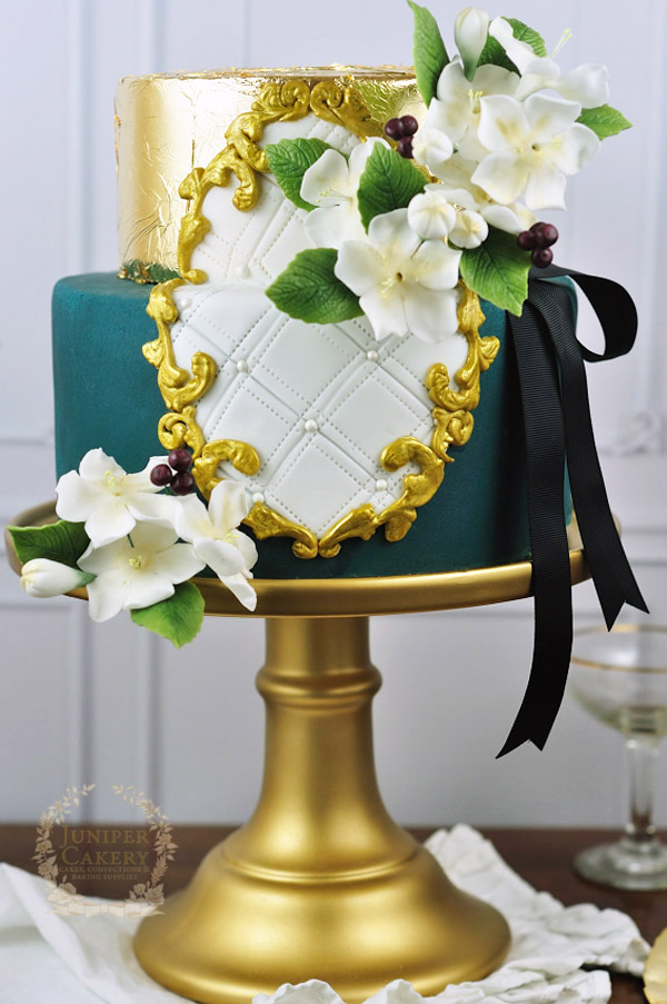 Gold painted frame cake by Juniper Cakery
