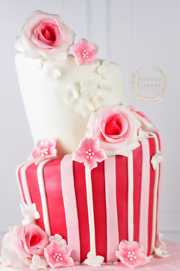 Pink floral topsy turvy cake by Juniper Cakery