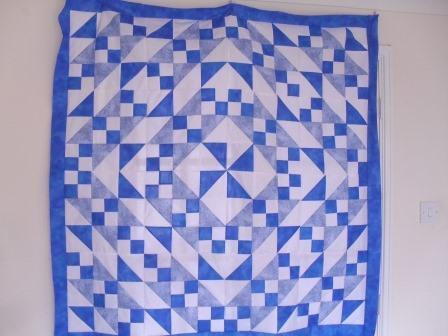 quilt using squares and half square triangles