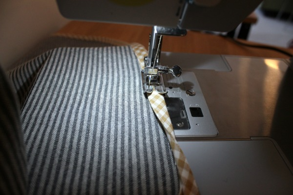 sewing on binding around cover edge