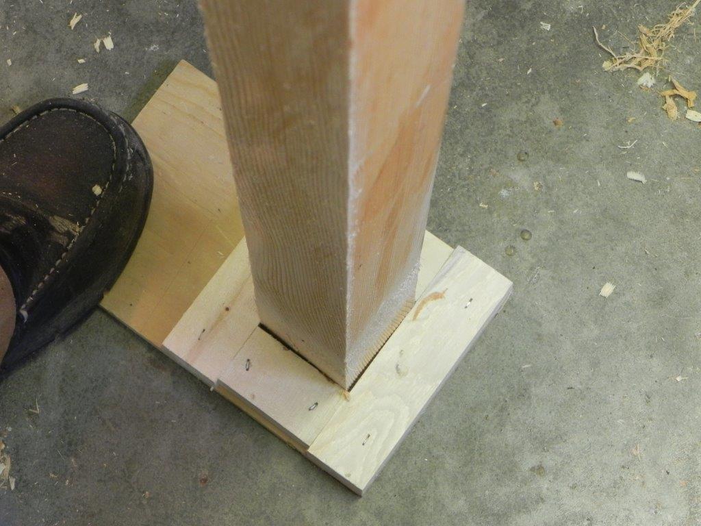 Center marker on the floor beside the lathe.