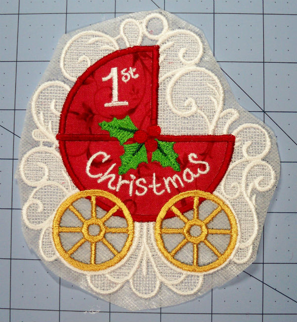Baby's first Christmas FSL ornament applique trimmed stabilizer