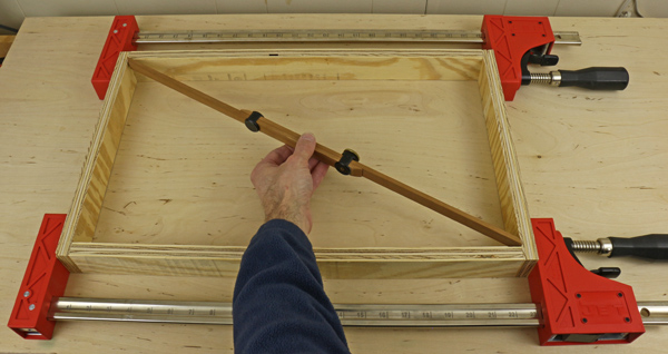 pinch rods squaring a frame