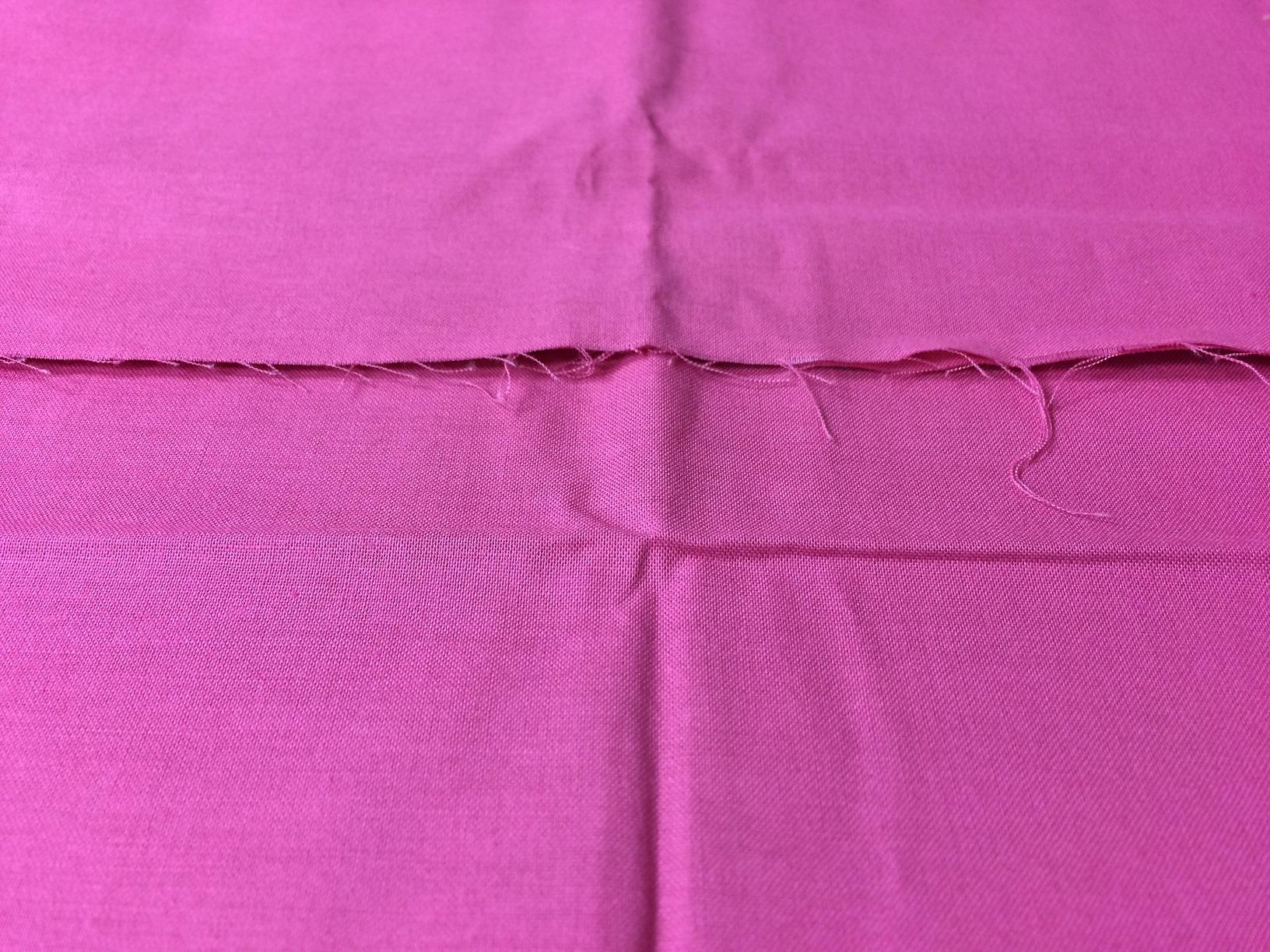 creased fabric yardage