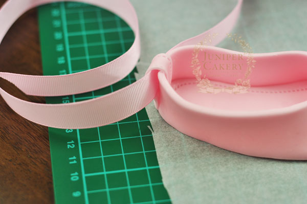 Add ribbon to fondant ballet slippers