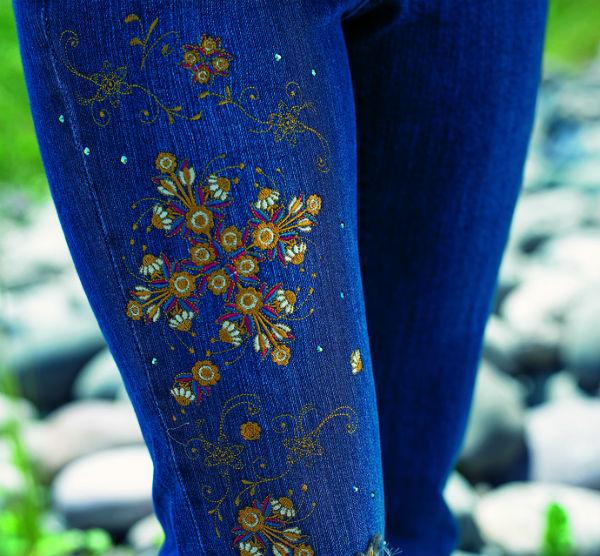 Bright threads embroidered on denim.