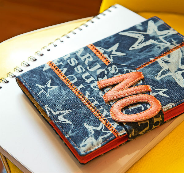 Embroidered denim notebook cover.