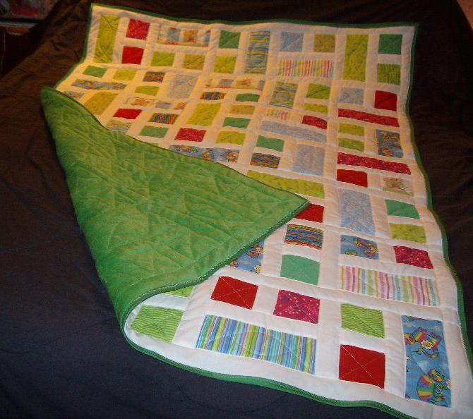 Geometric quilt with green fleece back