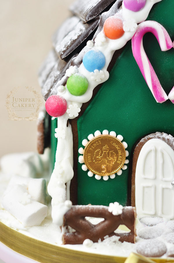 Fun candy decorated gingerbread house by Juniper Cakery
