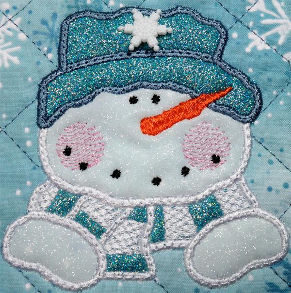 Applique snowman mug rug with glitter flex vinyl.