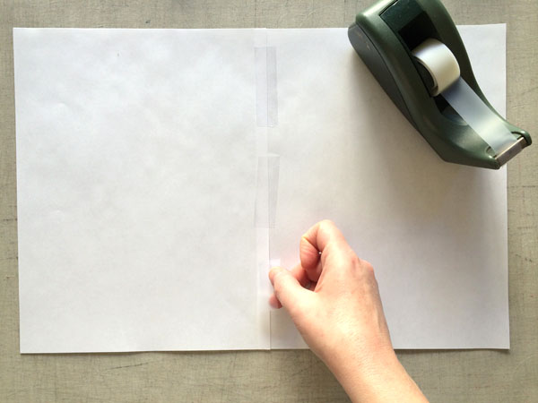 tape paper together