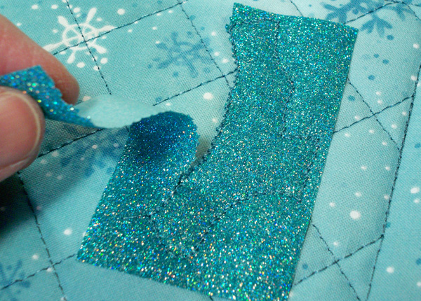 Tear away glitter flex vinyl used with applique.