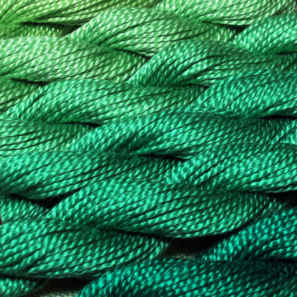 Close-up shot of green perle cotton thread
