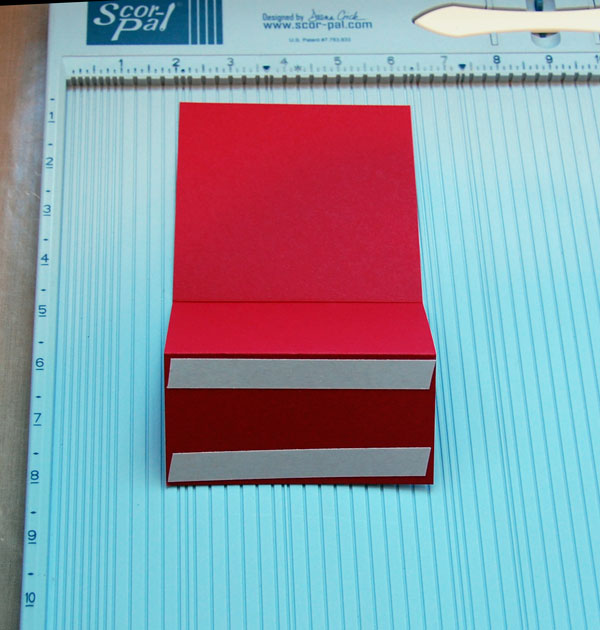 Double-sided tape adhered
