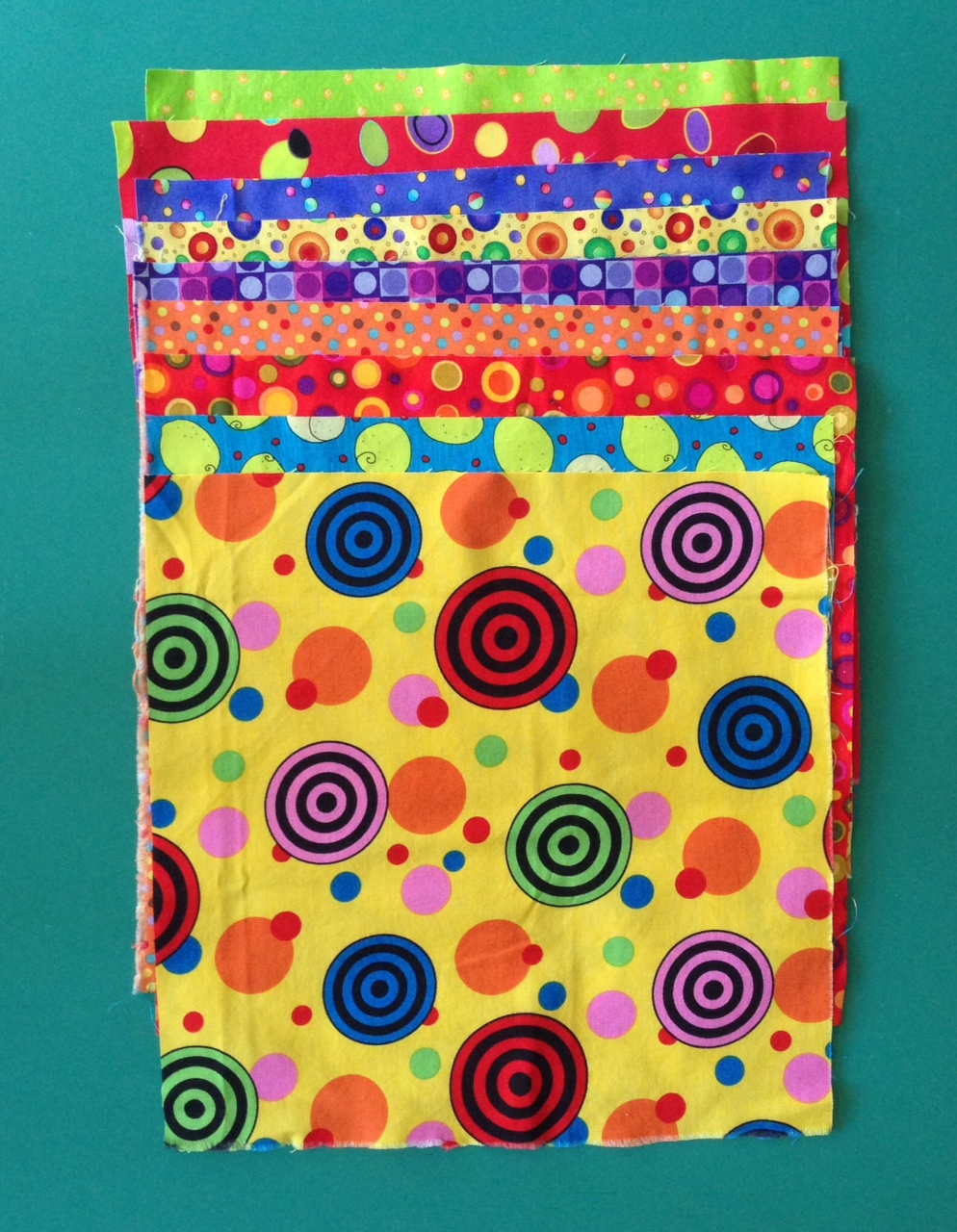 Stack of dotted fabrics for crazy nine patch