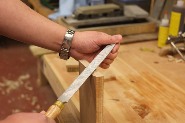 Two handed grip for using a rasp