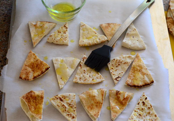 Brushing Pita Chips with Olive Oil