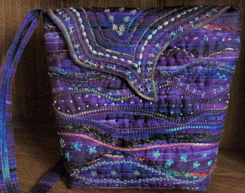 Purple Bag With Stitched Embellishments