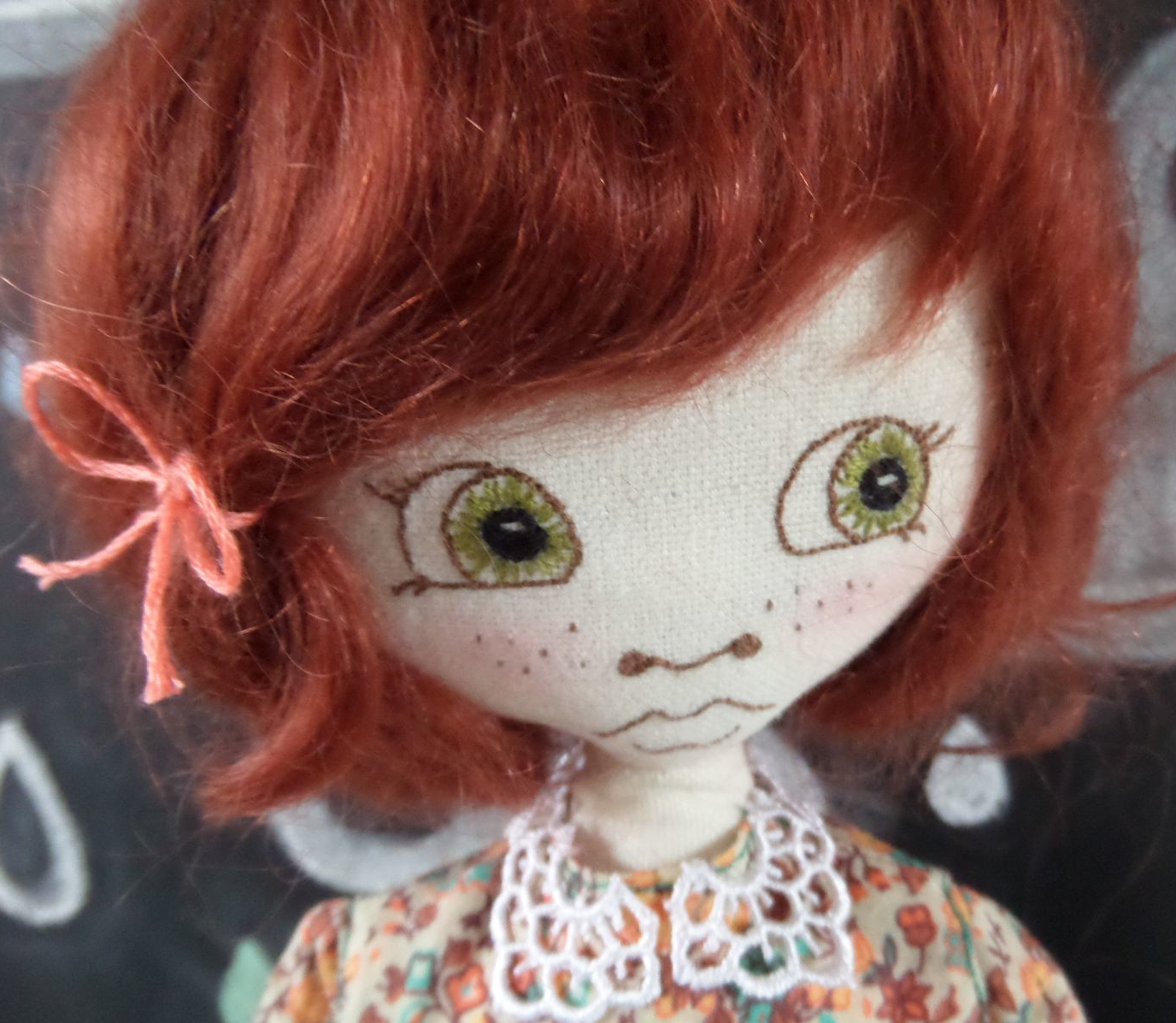 Beautiful hand embroidered eyes on this stunning doll by Supercutetilly