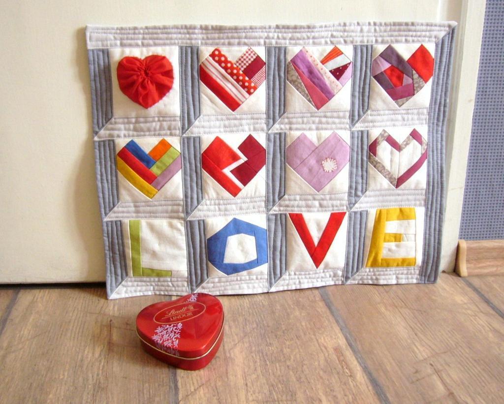 Paper pieced Valentine LOVE hearts quilt