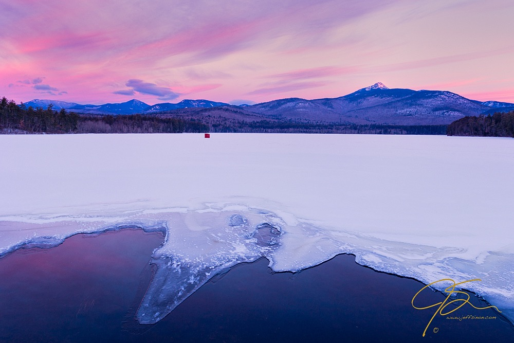 Beautiful winter sunrise over snow and ice covered Chocorua Lake, NH