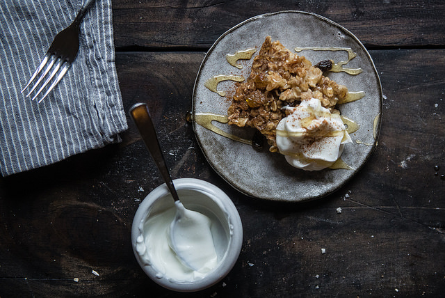Slice of oatmeal cookie baked oatmeal with greek yogurt + honey