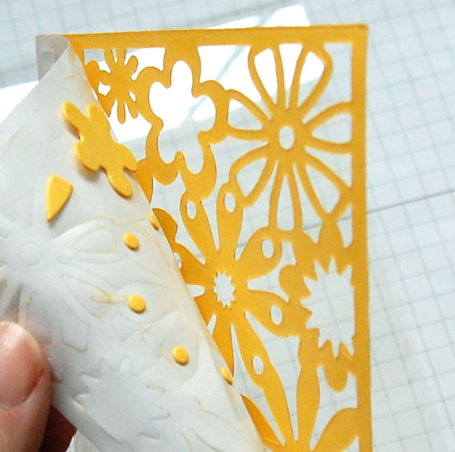 Step 4 Remove adhesive liner and negative die-cut pieces