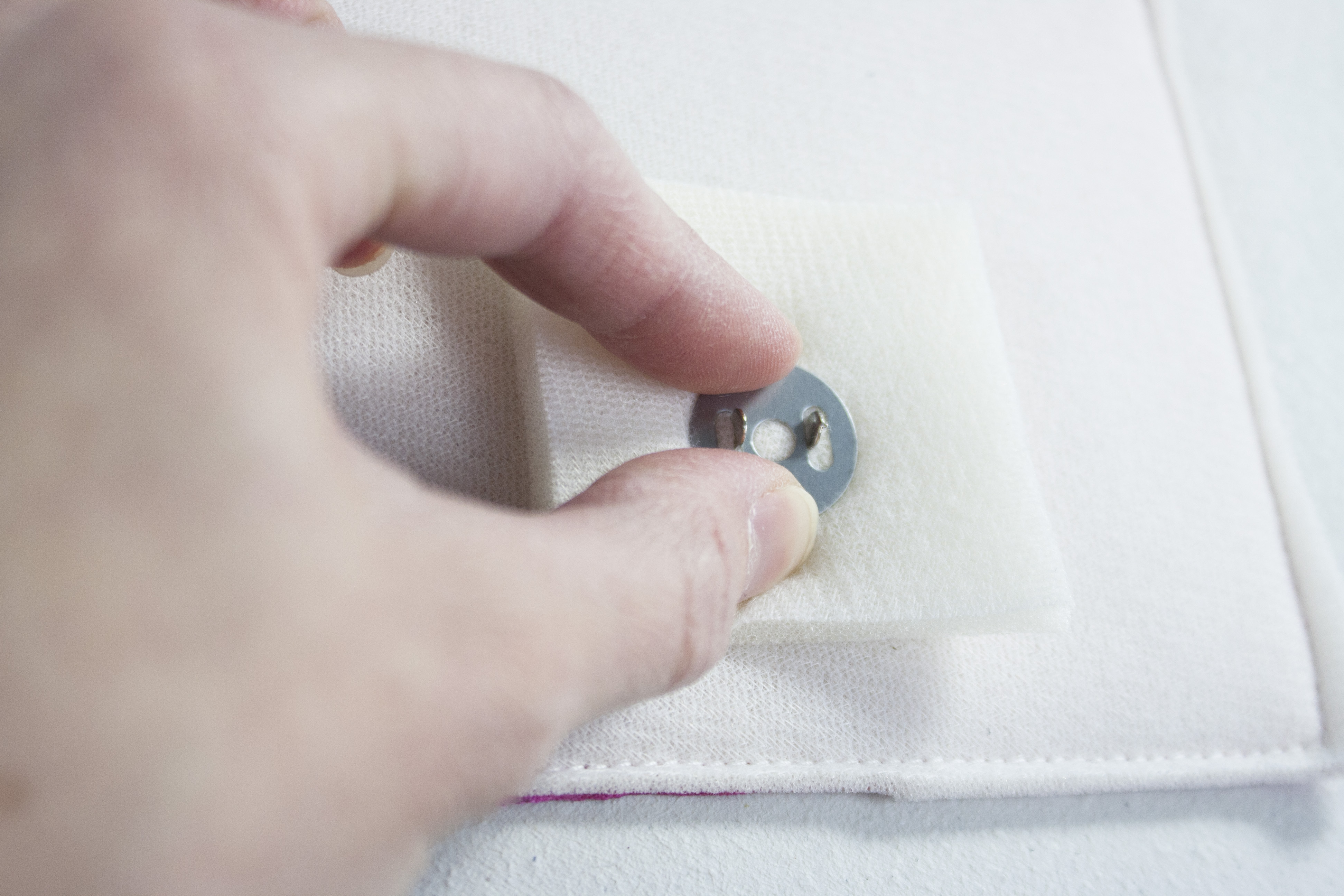 Inserting the snap through the fabric/interfacing.