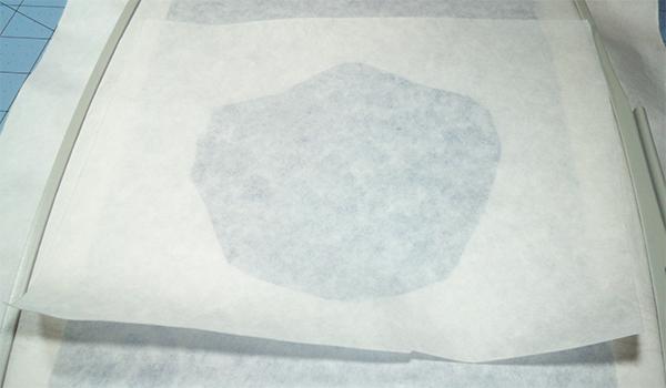 applying adhesive stabilzier to back of stabilizer window