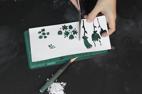 Cutting around stencils with scissors