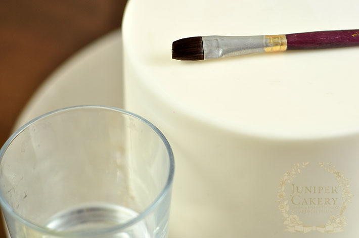 Add edible gold leaf to cakes for a luxurious look