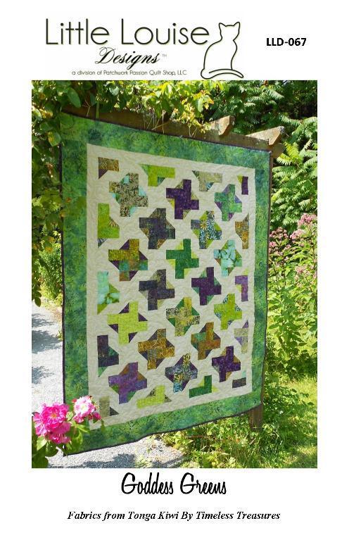 green spinning blocks pieced quilt